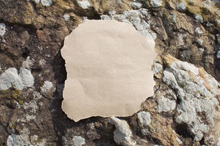 Empty Space on Paper with Rock Background Stock Photo
