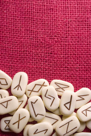 rune: Runic stones, for astrological consultation, past, present and future.Red background.