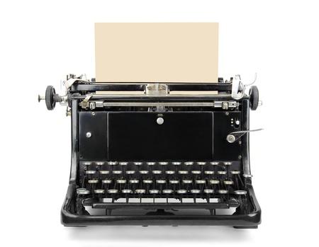 typewriter: M�quina de escribir vieja con una hoja en blanco aislado en blanco Foto de archivo