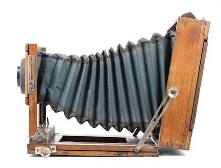 bellows: Old wooden large format camera with green bellows isolated on white background