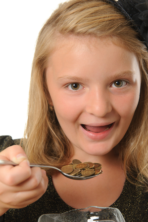 Girl eating coins photo