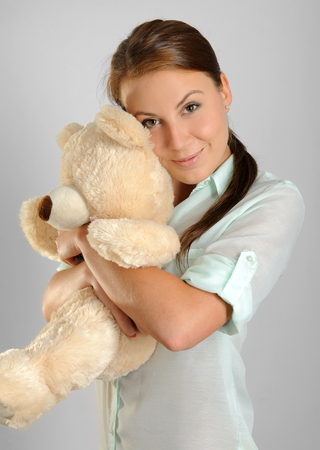 Young woman holding a teddy bear photo