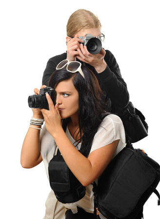 Fotógrafos aislados en blanco