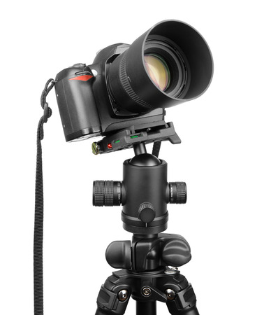 DSLR camera on tripod isolated on white. photo