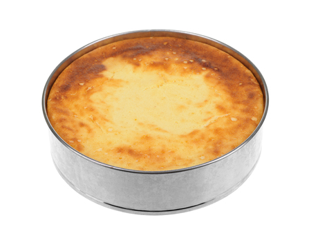 cheese cake: Cheesecake in aluminum pan isolated on white.