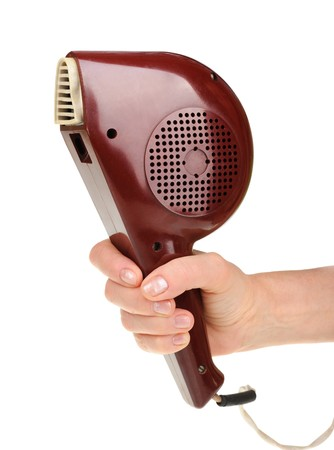 Hand holding an old hairdryer isolated on white background Stock Photo