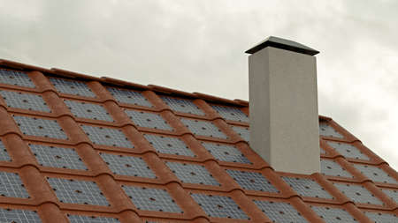 Roof of solar tiles with chimney, cloudy weather Stockfoto