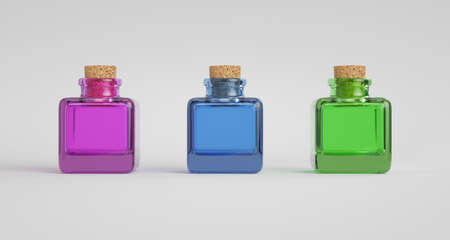 Three colorful glass jars with cork stopper. Light background