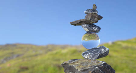Tower of stones in balance (Rock Balance) with a crystal sphere holding the upper stones. 스톡 콘텐츠