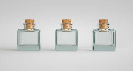 Three square glass containers with a cork stopper. White background. Stok Fotoğraf