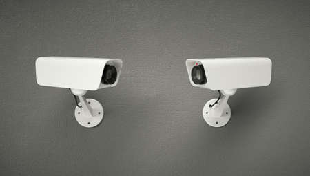 Two security cameras looking at each other.