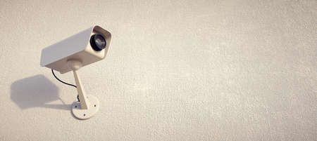Security camera watching the horizon. Installed on the wall. Stock Photo