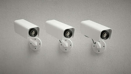 Three security cameras watching the same point. Gray background.
