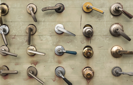 Various front door handles are exhibited  Concept of door handles for vintage and workshop background Stok Fotoğraf