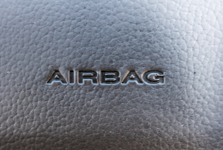 detail of the airbag device  on leather steering wheel Close-up  Car Handle Parts Airbag Stok Fotoğraf