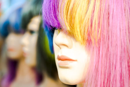 Beauty mannequins with dyed wigs in various colors
