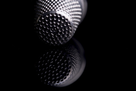 upholsterer: Detail of thimble cutico on a black background mirror