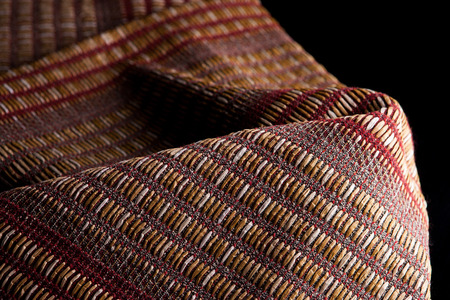 Upholstery fabrics on a black background