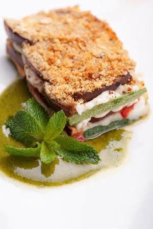 Parmigiana vegetable cream of basil and fresh basil leaves Фото со стока