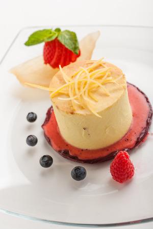 Cheesecake and fruits Фото со стока
