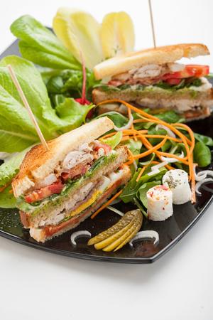 Sandwich on a black dish
