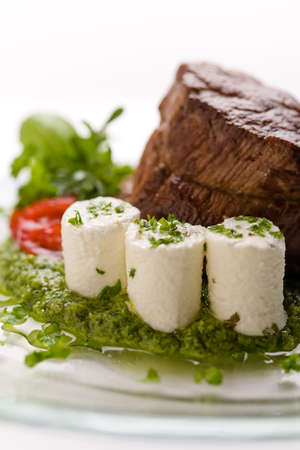 Beef roasted on green sauce with fresh roasted Beef cheese on green sauce with fresh cheese