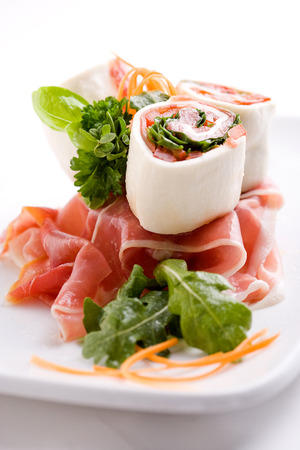 daniele: fresh mozzarella cheese roll topped with seasonal vegetables and omelette Stock Photo