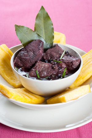 Stew meat, recipe carbonade in white bowl on white plate