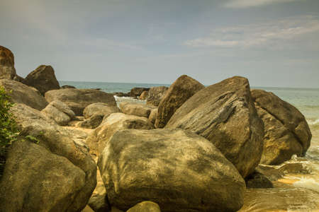 endlessness: rocks in front of the shining turquoise-blue Indian Ocean at the tropical island Sri Lanka Stock Photo