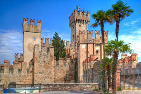 southward: Scaliger Castle in Sirmione at the Lake Garda in Italy in historically and playful architecture