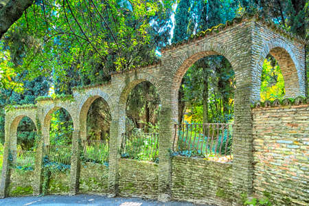 southward: walls around a garden in Sirmione at the Lake Garda in Italy Editorial