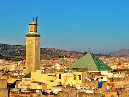 suq: View over the roofs of the Fez in morocco mosque with a beautiful and luminous blue sk