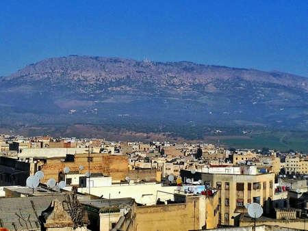 suq: View over of Fes in morocco with a lot of satellite dish and luminous blue sky Stock Photo