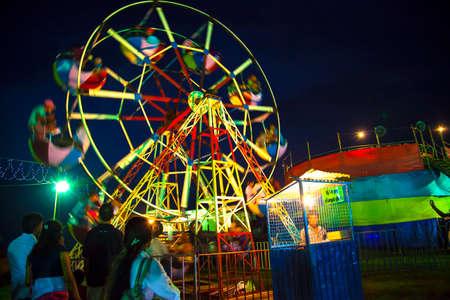 carny: A Ferris Wheel veers by a big folk festival in the famous portuguese Fort in Galle, Sri Lanka