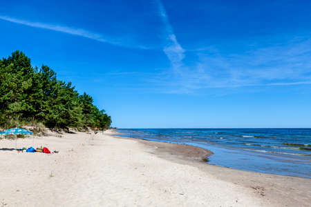 brightly: a brightly blue shining sky arches over a beautiful beach landscape at the baltic sea in Latvia, one of the baltic states Stock Photo