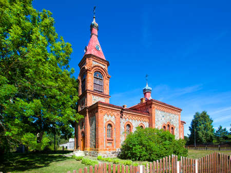 big bible: of Orthodox church in Kolka at the Latvian Baltic sea with a shining blue summer sky Stock Photo