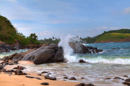 blow hole: rocks  bathed by the Indian Ocean of the tropical island of Sri Lanka Stock Photo