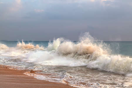 blue summer sky: wild waves at the coast of Sri Lanka in the Indian Ocean