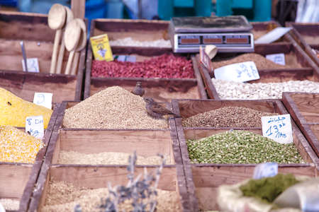 grandiose: colorful spices, herbs and seeds on an oriental market n the medina of the african harbor city Agadir in Morocco