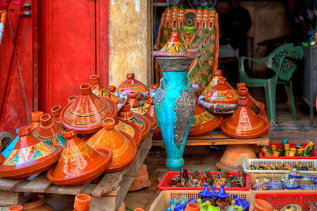 fes: pots of terra cotta and stoneware for the traditional delicious dishes Tajine and Couscous with partially colorful decorative ornamental painting are exposed for sale on a market in the Medina of Fes in Morocco in Africa Editorial