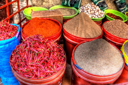Oriental spices and seeds like saffron and chilli powder are exposed for sale on a market in the medina of Fes in Morocco in Africa