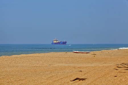 fishermans net: Dreamful bathing beach at the coast near Marawila on the tropical island Sri Lanka in the Indian Ocean with luminous blue sky