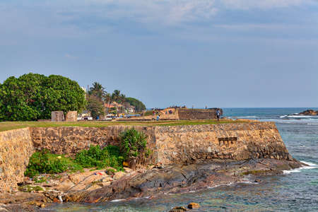 View to the mighty walls of the historical Galle Fortress on the tropical island Sri Lanka in Asia in the Indian Ocean with beautiful blue sky