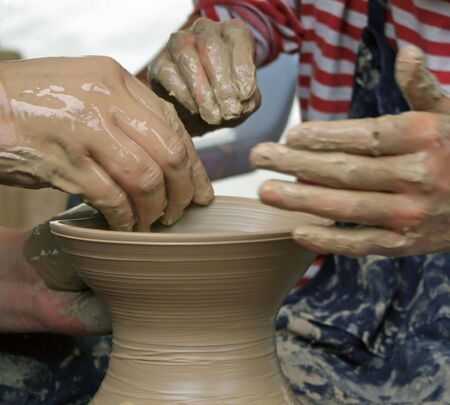 the flair: Student learning how to make pottery Stock Photo