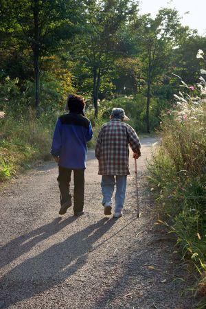 stroll: Elderly couple taking a stroll
