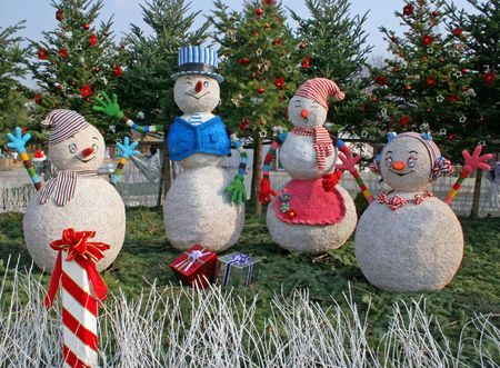 christmas scene: Four snowmen in a Christmas scene Stock Photo