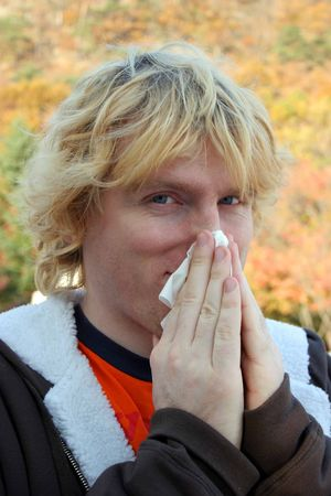 hankerchief: Man with a cold blowing his nose Stock Photo