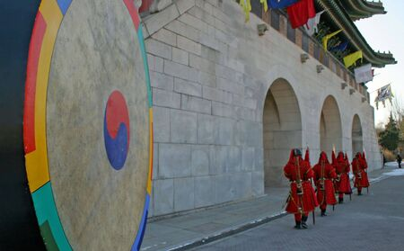 Guards on duty at Gyeongbokgung Palace, Seoul, South Korea photo