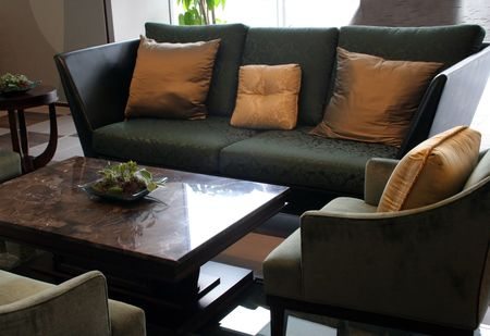 Sofas, chairs and a table in a living room photo