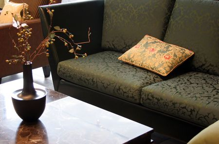 A sofa and table in a living room photo